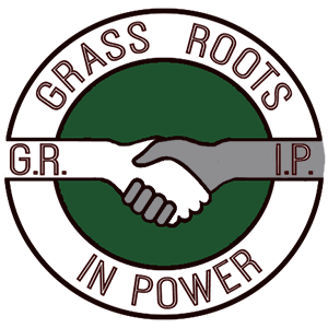 Black arm and white arm shaking hands in middle of Grass Roots in Power logo